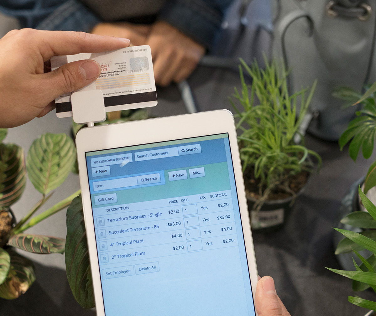 Photo of a credit card transaction with a tablet