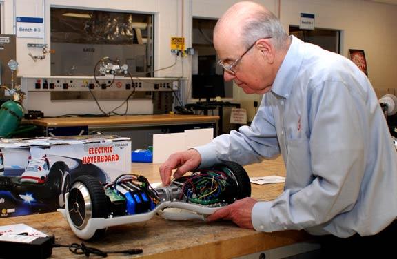 Image: John Drengenberg inspecting a hoverboard