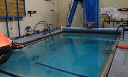 Full-sized pool with a tiered platform for water entry tests, a raft for exit tests and other, miscellaneous tests.
