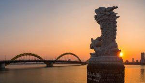 view of the dragon bridge over the water in da nong, vietnam