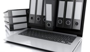 archive concept. laptop and files on isolated white background
