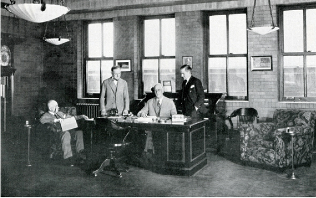 "UL President Dana Pierce (sitting at desk) in his office in 1930. One employee remembered him as ""a charming and cultivated gentleman who kept us afloat during the depression."""