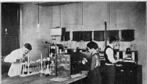 UL chemists workiing on a counter circa 1920s