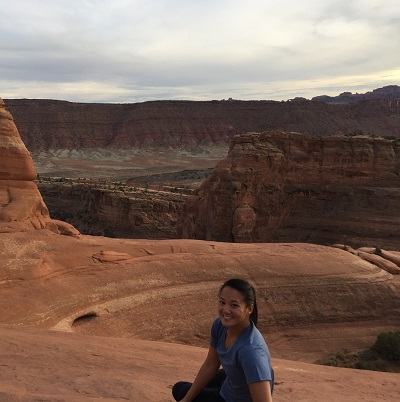 picturesque view of the Grand Canyon with Ellen in the foreground.