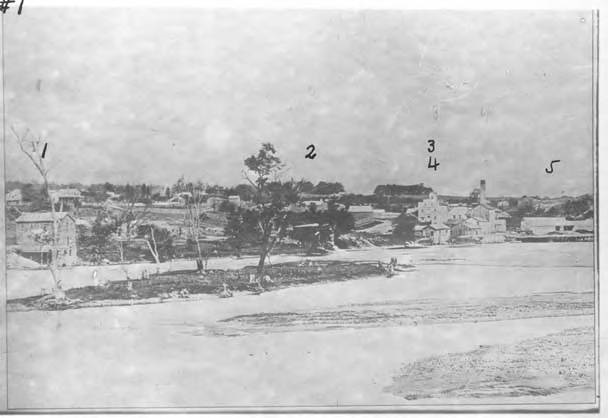 1866 photo from the Gail Borden Public Library shows Clarks Planning Mill (1), Spillards Tannery (2), Lawrence Maloney & Co. distillery (3), W.C. Kimball Saw Mill (4) and a river dam (5).